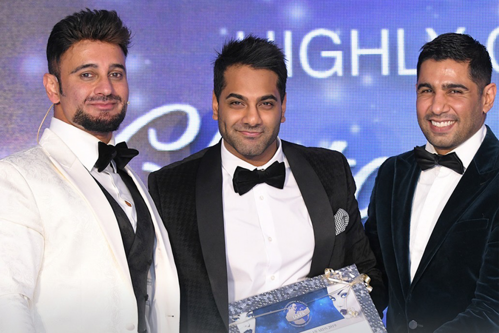 Birmingham and Wolverhampton Cosmetic Dental Surgeon, Chetan Sharma, receiving an award.
